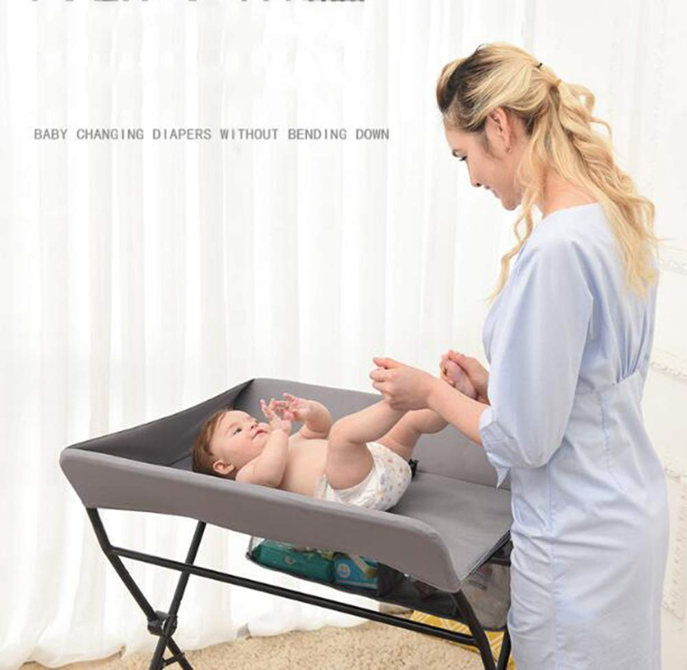 Baby Changing Table Baby Storage Bath Tub Unit Station Dresser Foldable Cross Leg Style AA-SS-Baby Changing Table 【Two in One Design】This baby changing table can be used as baby massaging table as 【Stable Construction】Non-skid feet covers and a sturdy frame keep the table stable and prevent movement. 【Waterproof Material】The surface of the top table is made of durable and wearable Oxford cloth and it can be used for a long period. 2