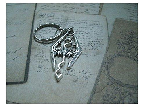 Portachiavi o collana o orecchino che rappresenta un drago in metallo argentato - Skyrim - Morrowind - Oblivion - The Elder scrolls