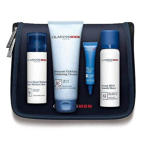 Clarins Men Confezione Regalo 50ml Balsamo Idratante + 125ml Detergente Esfoliante + 50ml Smooth Shave + 10ml Siero Occhi + Borsa
