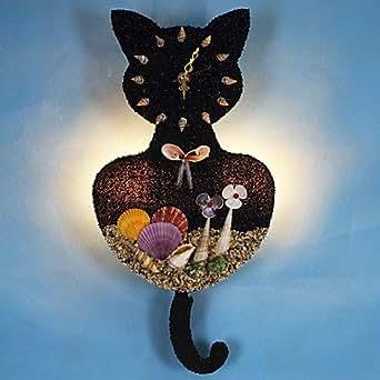 Horloge murale avec chat noir