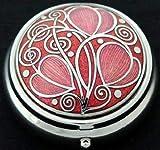 Boîte à pilules avec motif tourbillons celtes