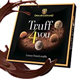 Chocolate truffles assorted dusted with cacao, Oskar le...