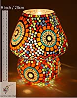 This dome shaped table glass lamp has colourful glass crystal all over its body. Beautiful small and big flowers along with these crystal glass increases its beauty. This lamp increases appeal to its surrounding when powered by artificial yellow or w...