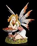 Kleine Elfen Figur lehtn sich an Fliegenpilz - Fee Fairy Fantasy