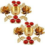 During the Hindu holiday of Diwali, it is common place for Indian families to fill their home with beautiful Diwali lights called Diwali diya. These Diwali decorations may be used as Diwali puja or offerings or used beside temporary artworks called D...