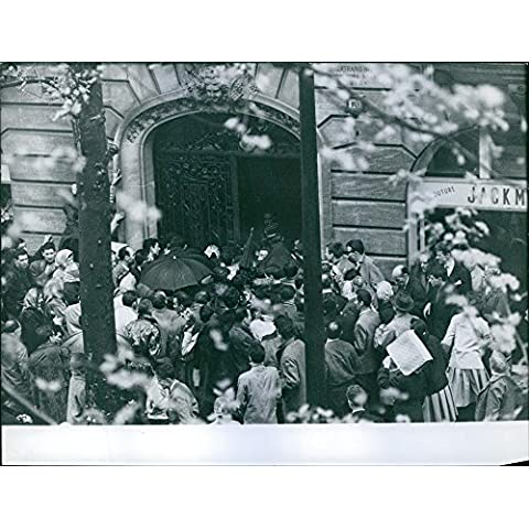 Vintage photo of People gathered in front of a gate.Peugeot