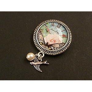 Brosche mit Uhr und Schmetterling in rosa silber