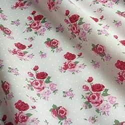 Tela de polialgodón a lunares con diseño de rosas, disponible en varios colores. (Se vende por metros)