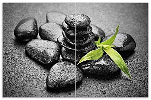 Wallario Herdabdeckplatte/Spritzschutz aus Glas, 2-teilig, 80x52cm, für Ceran- und Induktionsherde, Motiv Bambustrieb auf schwarzen Steinen, benetzt mit Wasser-Tropfen