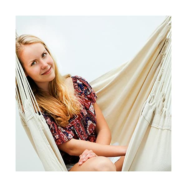 AMANKA Innovative XXL Swing Chair 185x130cm Hanging Seat made of cloth Beige AMANKA SAFER: INNOVATIVE ANTI-SLIP SYSTEM - no risk that the hammock slips off the spreader-bar: the ropes are firmly fixed to the wooden bar and the large canvas is hung with two sturdy metal hooks EXTRA LARGE PIECE OF CLOTH - the strong canvas is made of natural cotton. It is large approx. 185 x 130 cm, so there is plenty of space to sit and even lie down, both alone and in 2 people - suitable for adults and kids SINGLE-SPREADER BAR MADE OF WOOD - the longer the spreader bar, the more comfortable the hammock. Our four-square bar is 115 cm long! It will soon become your favorite spot for reading, dreaming and playing - perfect even as a children's swing 7