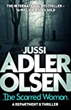 Front cover for the book The Scarred Woman by Jussi Adler-Olsen