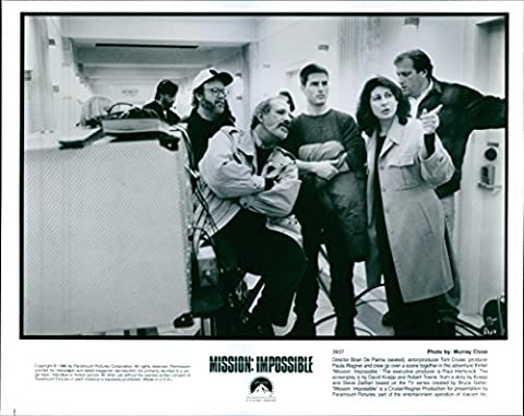 Vintage photo of Director Brian De Palma (seated), actor/producer Tom