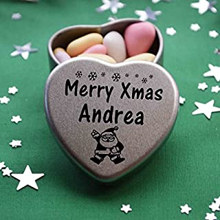 Merry Xmas Andrea Mini Heart Gift Tin with Chocolates Fits Beautifully in the palm of your hand. Great Christmas Present for Andrea Makes the perfect Stocking Filler or Card alternative. Tin Dimensions 45mmx45mmx20mm. Three designs Available, Father Christmas, Snowman and Snowflakes. They also make perfect Secret Santa Gifts.