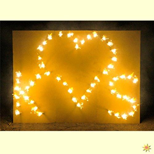 Lichterbild brennendes Herz mit zwei Buchstaben thumbnail