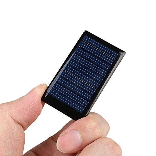 Especificaciones:  Condición: 100% nuevo  Color: inkiness  Material: Tensión de salida silicio : Potencia de salida de 5V : Corriente de salida 0.15W  : 30mA  tamaño del producto: 5.2 * 2.9 * 0.3cm  El paquete incluye:  1x mini panel solar