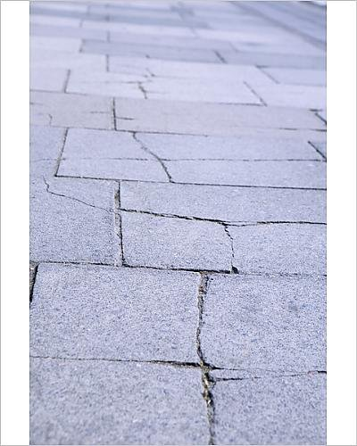 photographic-print-of-cracked-slabs-on-pavement-requiring-repair