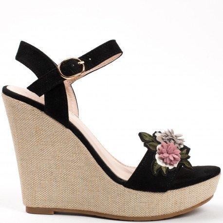 Ideal Shoes - Sandales compensées effet daim avec patch fleur Lilona Noir