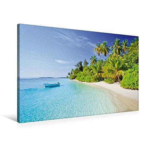 Premium Textil-Leinwand 90 cm x 60 cm quer, Kleines Boot schaukelt vor einem tropischen Strand mit Kokospalmen | Wandbild, Bild auf Keilrahmen. Malediven, Indischer Ozean (CALVENDO Orte)