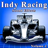 Cart Indy Car Pit Ambience with Pa, Crowds, Crews Working on Cars and Cars Revving at High Rpm Levels Take 2