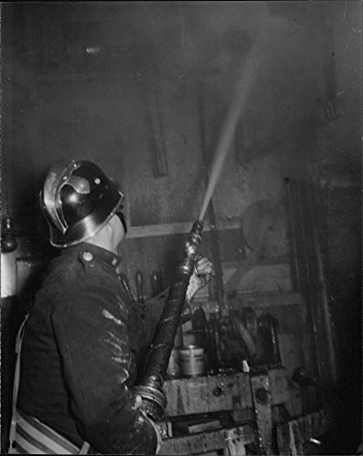 vintage-photo-of-fire-in-bone-meal-factory-in-traneberg-firefighter-extinguishes-fire