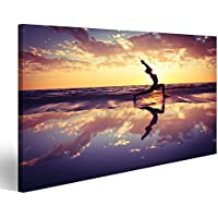 Cuadro Cuadros Silueta de una mujer practicando yoga en la playa al atardecer Impresión sobre lienzo - Formato Grande - Cuadros modernos EUV