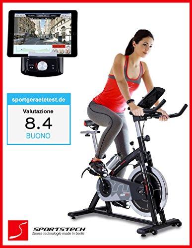 Cyclette professionale Sportstech SX200 con controllo attraverso un'app per smartphone + Google Street View, volano da 22KG, supporto braccio, compatibile con cintura polso – ergometro fino a 125 KG