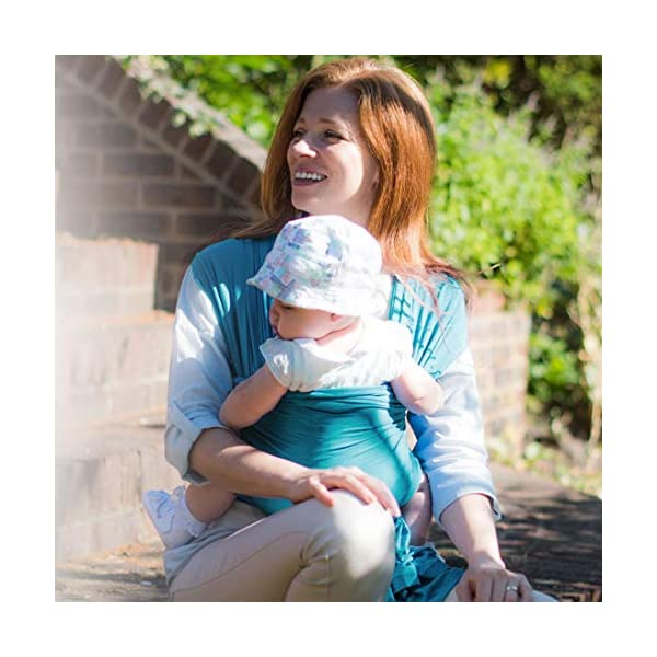 Izmi Wrap, Made from Soft Bamboo, Ideal for Newborns, Teal Izmi Ideal for use with new born babies (2.3kg-9kg) 2 carrying positions: front carry or hip carry Made from super soft Bamboo fabric that holds your baby in a snug comfortable position 3