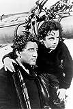 Moviestore Freddie Bartholomew als Harvey Cheyne unt Spencer Tracy als Manuel Fidello in Captains Courageous 91x60cm Schwarzweiß-Posterdruck