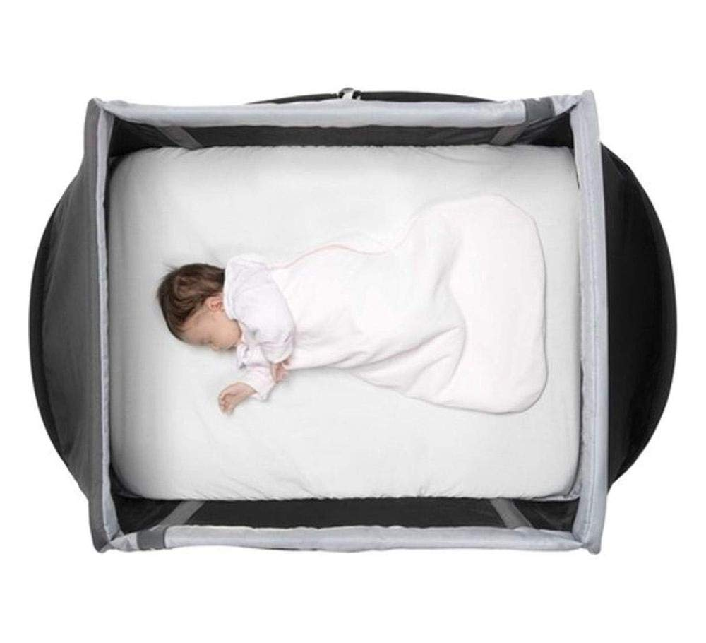 AEROMOOV - Instant Travel Bed - Allows Your Child to take a nap Wherever You are - Light and Compact - White Sand AeroMoov COMPACT AND LIGHT: No more carrying a heavy and bulky travel bed! The AeroMoov Instant Travel Bed weighs less than 5kg and is easy to store thanks to its slim and elegant storage bag. TO BE TAKEN EVERYWHERE: At Grandma and Grandpa's, on the beach or in your garden, allow your little one to take a pleasant nap or play, without ever losing sight of him thanks to the transparent sides. FAST ASSEMBLY AND STORAGE: Installing your Instant Travel Bed becomes child's play. Mount and dismantle it in just 2 seconds. 4