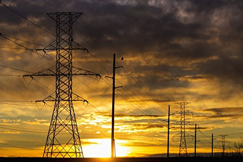 michael-interisano-design-pics-silhouette-of-large-metal-powerline-towers-with-colourful-clouds-and-