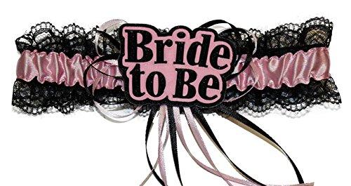 Preisvergleich Produktbild Strumpfband rosa Satinband schwarze Spitzen mit der Aufschrift Bride-to-Be Junggesellenabschied
