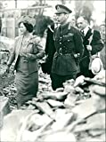 Vintage photo of King George VI and Queen Elizabeth touring bombed districts in north west London