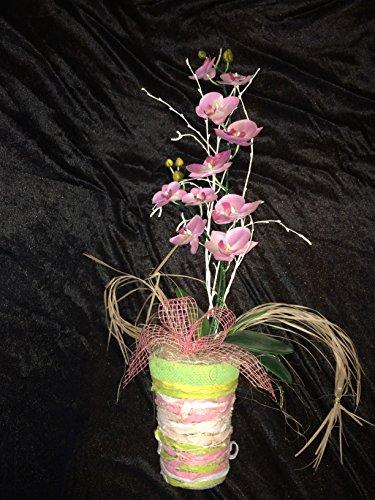 Gesteck mit rosanen Orchideen