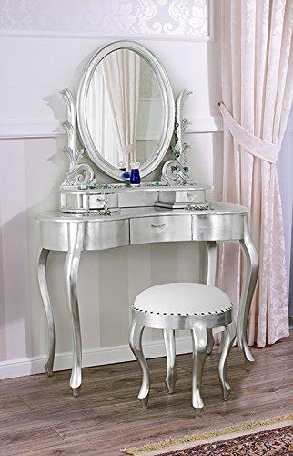 Conjunto de tocador bailarina plateado estilo barroco. Espejo ovalado y taburete de maquillaje color plata.