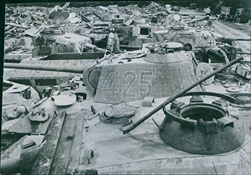 Reprint of Wrecked and abandoned German tanks and equipment fill a collection depot at Isigny, northern France, awaiting salvage by Allied technicians.