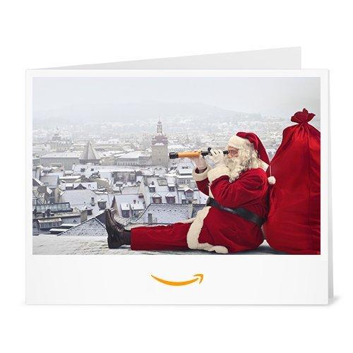 cheque-regalo-de-amazones-imprimir-papa-noel-en-lo-alto-de-un-edificio