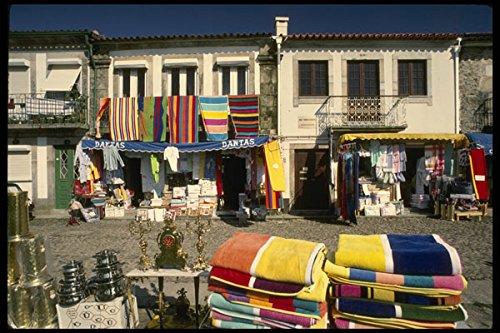 256028 Colorful Merchandise Along Cobblestone Streets A4 Photo Poster Print 10x8