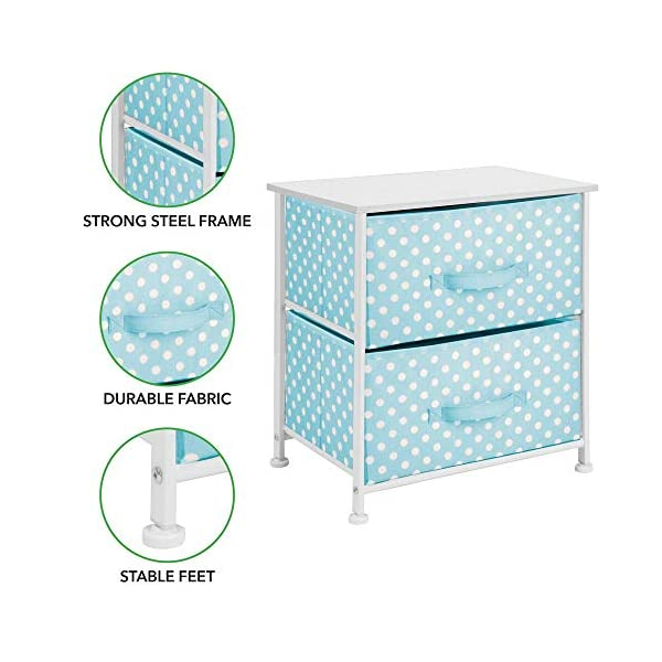 mDesign Chest of Drawers - Children's Bedroom Storage System with 2 Drawers and Flat Top - Nursery Storage Unit with Polka Dot Design - Turquoise/White mDesign SWEET STORAGE: This 2-drawer side table is a must-have accent to complement any child's room. The bright turquoise fabric is adorned with a sweet white polka dot pattern. STORE ANYTHING: The bedroom drawers are a versatile unit and can be filled with anything. Use to store toys, accessories, clothes, books, nappies and more. VERSATILE UNIT: Although the unit works best as bedroom storage, its uses do not stop there. Place in play rooms, nurseries and other child-specific areas of the home. 3