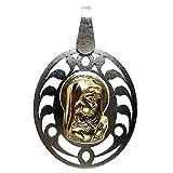 Medalla oro y plata Virgen Nina oval calada Au 18k y Ag Ley. Largo con asas (mm.): 31. Ancho (mm.): 20. Peso (gr.): 2,3