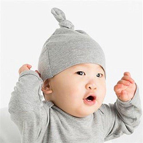 Bebé del sombrero de un nudo
