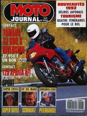 MOTO JOURNAL [No 1003] du 12/09/1991 - CONTACT : YAMAHA XJ 600 S. DIVERSION. 32 950 F. UN BON COUP. CONTACT : 125 APRILIA AFI. SPORT : SUPER CROSS, SUPER BAYLE. GP DU MANS, SCHWANTZ. ENDURO-ISDE, PETERHANSEL. NOUVEAUTES 1992 : DELIRES JAPONAIS. TOURISME : QUATRE ITINERAIRES POUR LE BOL.