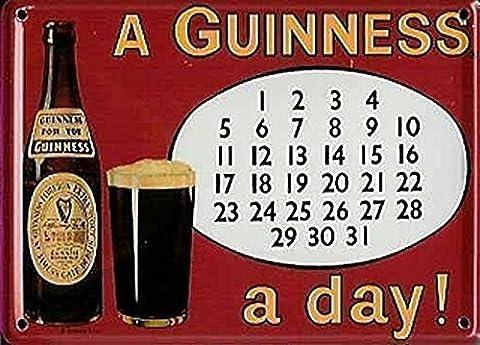 Plaque en métal design calendrier Guinness pour