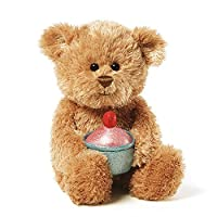 This little bear is holding a cupcake ready to celebrate any occasion!