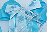 mit Schmetterlingen verzierte blaue Schleife für die Einschulung zum ersten Schultag, passend für die Schultüte