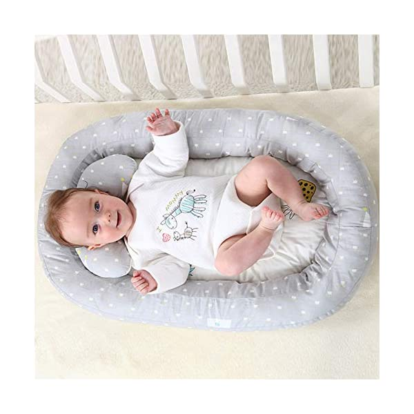 Moonvvin Portable Baby Lounger Breathable Hypoallergenic Co-Sleeping Baby Cot Bed Portable Crib for Bedroom/Travel  We use 100-percent cotton fabric and breathable, hypoallergenic internal filler, which is safe for baby's sensitive skin. It will give your child serene, safe, and sound sleep in their lovely co sleeping crib. Your child will feel comfortable and safe in our soft newborn lounger. Such a secure sleeper will allow your baby to have deep and nice sleep as little ones love the imitation of a stay in the mother's womb. It helps with common newborn sleep issues like wanting to sleep in a parent's arms or frequent waking. Use the infant lounger as a bassinet for a bed, side sleeper, travel bed, newborn pillow, changing station or move it around the house for lounging or tummy time, making baby feel more secure and cozy. The lightweight design and easy-to-use package with handle make our in bed bassinet a portable baby must-have. 2