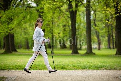 druck-shop24 Wunschmotiv: Nordic walking - middle-age woman working out in city park #123208894 - Bild als Klebe-Folie - 3:2-60 x 40 cm/40 x 60 cm