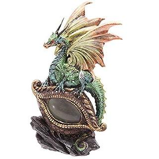 Statua di draghetto baby drago su occhio di drago led