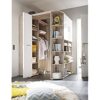 lifestyle4living begehbarer eckkleiderschrank wei betonfarbige lichtgraue faltt r. Black Bedroom Furniture Sets. Home Design Ideas