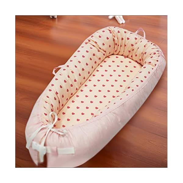 LNDD-Baby Nest Cushion Travel Bionic Uterine Bed Sleeping Pods Sleeping Bag Cotton Snuggle Suitable for Newborn Children From 0-18 Months,Orange LNDD ★COTTON FABRIC: This product is cotton fabric, surrounded by pp cotton padding, the bottom plate is a high-elastic sponge, which makes the small bed skin-friendly and better protects the baby's growth and development. ★IMITATION UTERUS DESIGN: 306° wrap around wraparound compact space as if in a familiar uterine environment, designed to sleep deeply throughout the night. ★RETRACTABLE DESIGN: 0-10 months to close the sleep Adjustable tightness helps to extend the sleep time in the middle of the night, 10-18 months to open the sleep to extend the use time to improve cost performance. 1