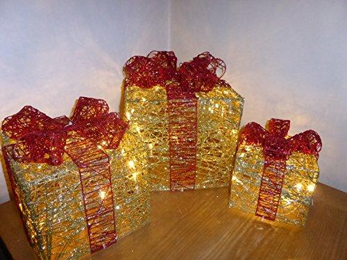 beleuchtete-weihnachtsdekoration-geschenkboxen-glitter-gold-und-rot-in-innenraumen-und-im-freien-zu-